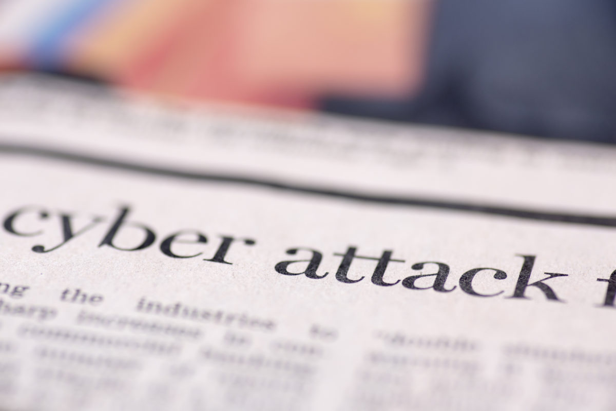 Cyber attack written newspaper, shallow dof, real newspaper.